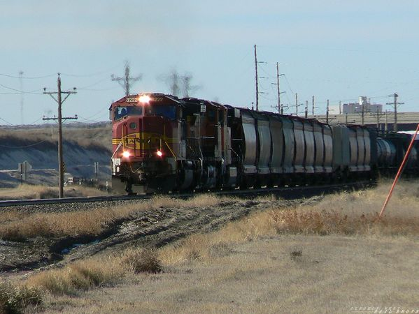 BNSF SD-75M leads freight